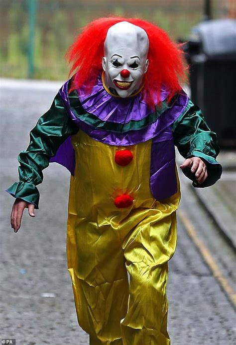 Police hunt 'killer clown' armed with a baseball bat after